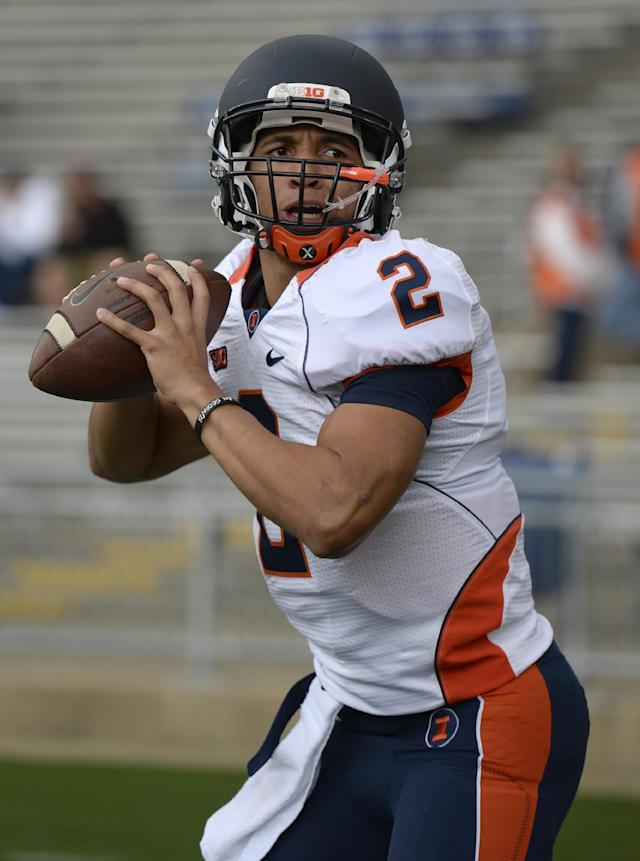 Illinois quarterback Nathan Scheelhaase warms up before an NCAA college football game against Penn State in State College, Pa., Saturday, Nov. 2, 2013. (AP Photo/John Beale)