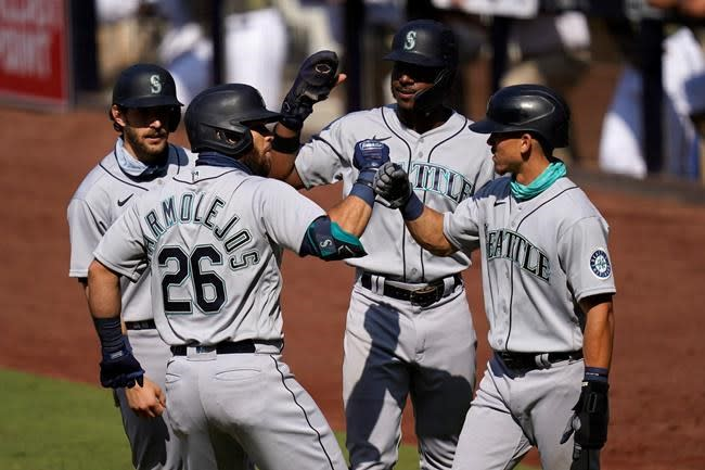 Marmolejos' first slam carries Mariners to 8-3 win, split