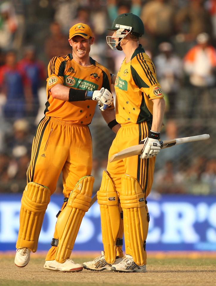GUWAHATI, INDIA - NOVEMBER 08:  Michael Hussey and Adam Voges of Australia celebrate winning the match and the seven match series 4-2 at the conclusion of the sixth One Day International match between India and Australia at Jawaharlal Nehru Stadium on November 8, 2009 in Guwahati, India.  (Photo by Mark Kolbe/Getty Images)