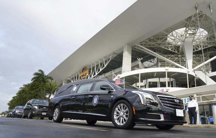 The hearse carrying the casket of FBI Special Agent Laura Schwartzenberger leaves a memorial service at Hard Rock Stadium on Saturday, Feb. 6, 2021, in Miami Gardens, Fla. Schwartzenberger and Special Agent Daniel Alfin were killed while serving a warrant this week in Sunrise, Fla. (AP Photo/Hans Deryk)