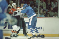 FILE - In this Oct. 21, 1988, file photo, then-Philadelphia Flyers' Rick Tocchet (22) takes a fist from Quebec Nordiques Greg Smyth during a first period fight during an NHL game, in Philadelphia. The Flyers are one of only two teams in the NHL without a fight a quarter of the way through this season. Arizona Coyotes coach Rick Tocchet holds the Flyers all-time penalty minutes record with 1,815 and fought 171 times during his career. (AP Photo/Amy Sancetta, File)