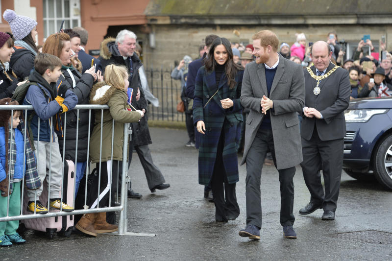 Prince Harry and Meghan Markle during a walkabout on the esplanade at Edinburgh Castle, during their visit to Scotland. (Photo by John Linton/PA Images via Getty Images)