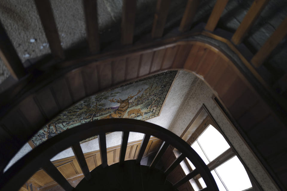 """The interior wooden staircase of the 120 sq. meters (1,300 sq. feet) stone house where the Nobel-winning scientist couple Marie Sklodowska-Curie and Pierre Curie spent vacation and weekends from 1904-1906 in Saint-Remy-les-Chevreuse, on the south-west outskirts of Paris, France, Wednesday, May 12, 2021. Poland's prime minister Mateusz Morawiecki says he's given instructions for the government to buy 790,000 euro house in France, and said on Twitter Tuesday that the house, is a """"part of Poland's history."""" (AP Photo/Francois Mori)"""