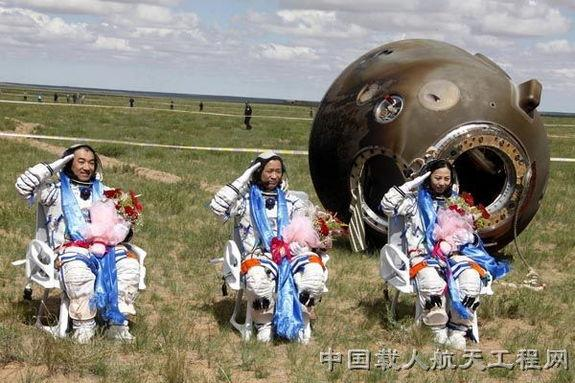 The crew of Shenzhou 10, China's fifth human spaceflight mission, salutes after a safe landing in inner Mongolia on the morning of June 26 local time in 2013. The crew is, from left: Zhang Xiaoguang, Shenzhou 10 commander Nie Haisheng and Wang