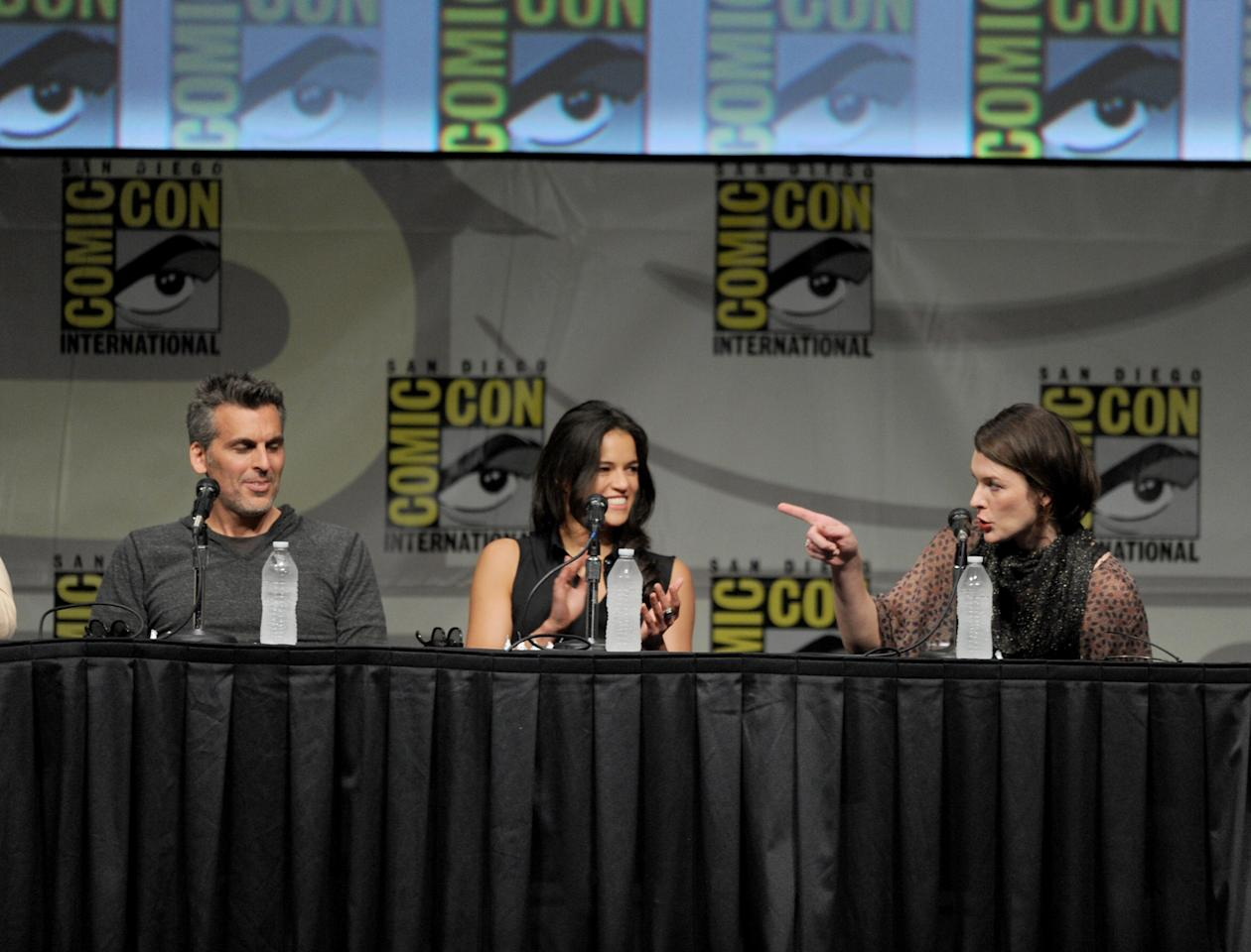 "SAN DIEGO, CA - JULY 13:  Actors Oded Fehr, Michelle Rodriguez, and Milla Jovovich speak at the Screen Gems' ""Resident Evil: Retribution"" panel during Comic-Con International 2012 at San Diego Convention Center on July 13, 2012 in San Diego, California.  (Photo by Kevin Winter/Getty Images)"