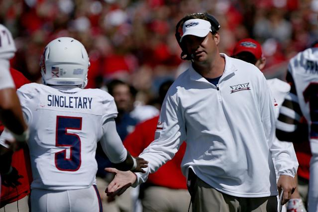 "MADISON, WI – SEPTEMBER 09: Head coach Lane Kiffin of the <a class=""link rapid-noclick-resp"" href=""/ncaab/teams/fav/"" data-ylk=""slk:Florida Atlantic Owls"">Florida Atlantic Owls</a> congratulates <a class=""link rapid-noclick-resp"" href=""/ncaaf/players/264882/"" data-ylk=""slk:Devin Singletary"">Devin Singletary</a> #5 after scoring a touchdown in the second quarter against the <a class=""link rapid-noclick-resp"" href=""/ncaab/teams/wbg/"" data-ylk=""slk:Wisconsin Badgers"">Wisconsin Badgers</a> at Camp Randall Stadium on September 9, 2017 in Madison, Wisconsin. (Photo by Dylan Buell/Getty Images)"