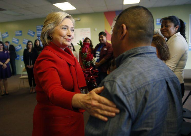 """Democratic presidential candidate Hillary Clinton, left, meets with people at an event to speak with young immigrants, or so-called """"dreamers"""" and their families at a campaign office Sunday, Feb. 14, 2016, in Las Vegas. (AP Photo/John Locher)"""