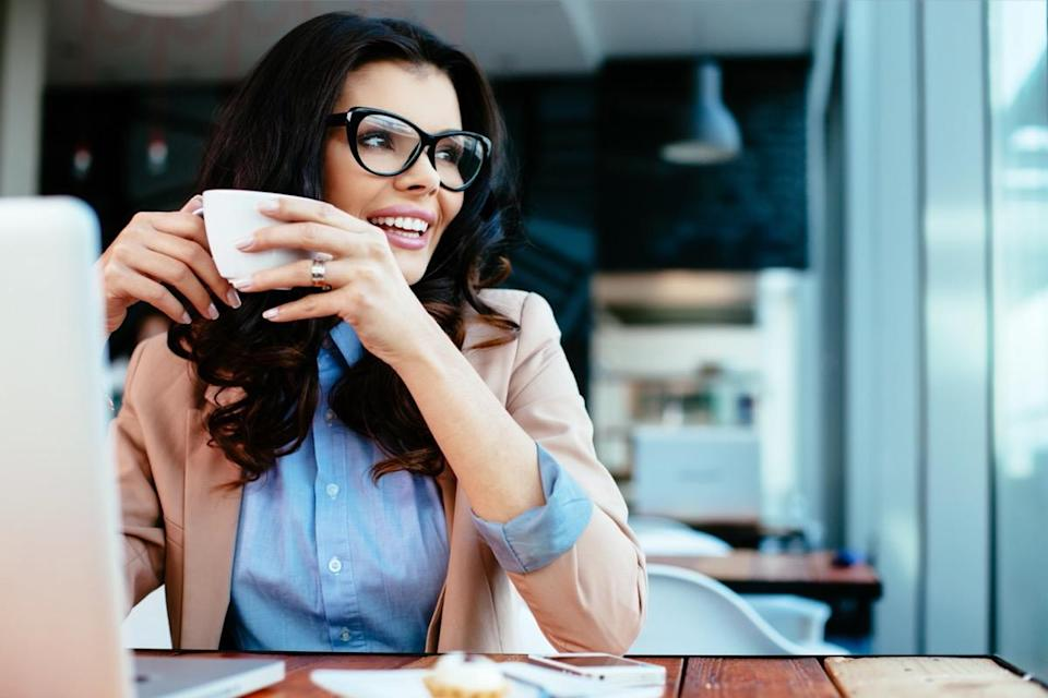 woman wearing glasses and drinking coffee