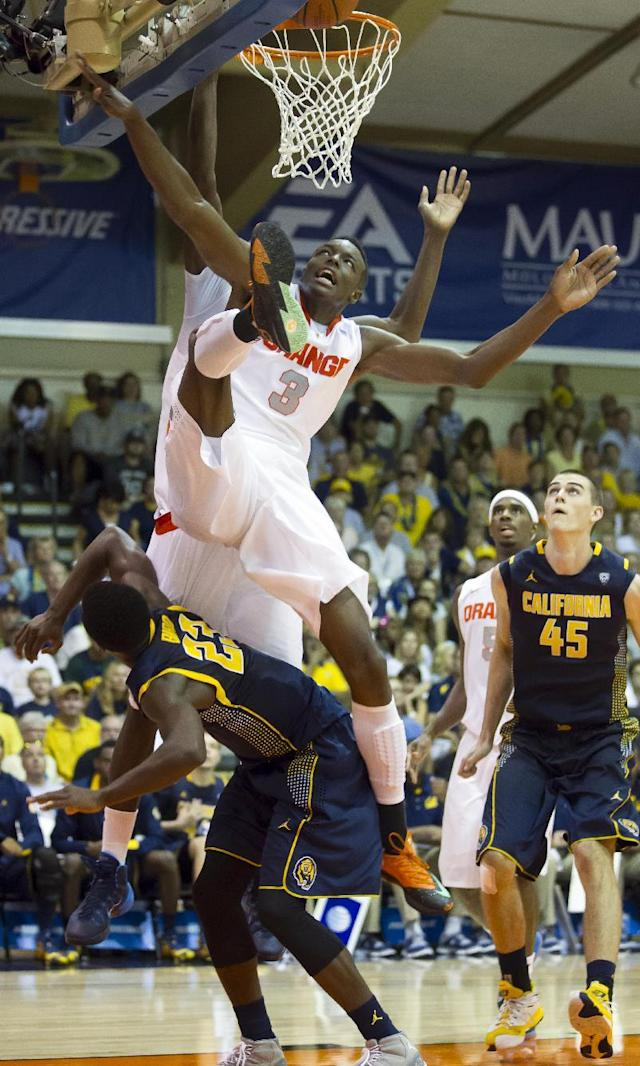 Syracuse forward Jerami Grant (3) keeps his eye on the basketball while trying to grab a rebound as California guard Jabari Bird (23) ducks under in the second half of an NCAA college basketball game at the Maui Invitational on Tuesday, Nov. 26, 2013, in Lahaina, Hawaii. Syracuse forward C.J. Fair (5) and California forward David Kravish (45) look on. Syracuse won 92-81. (AP Photo/Eugene Tanner)