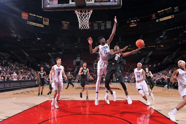RJ Barrett goes to the hoop in international action against the U.S. (Getty Images)