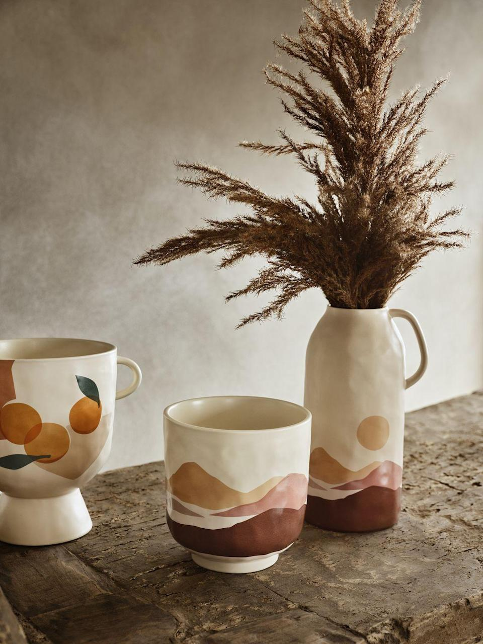 """<p>Display your favourite plant in this stunning stoneware pot, created by Célia Amroune and Aline Kpade from Sacrée Frangine in their Paris studio. Right up our street, it features colours inspired by Mediterranean shores and has a timeless matte finish. </p><p><a class=""""link rapid-noclick-resp"""" href=""""https://www2.hm.com/en_gb/productpage.1009577001.html"""" rel=""""nofollow noopener"""" target=""""_blank"""" data-ylk=""""slk:BUY NOW"""">BUY NOW</a></p>"""