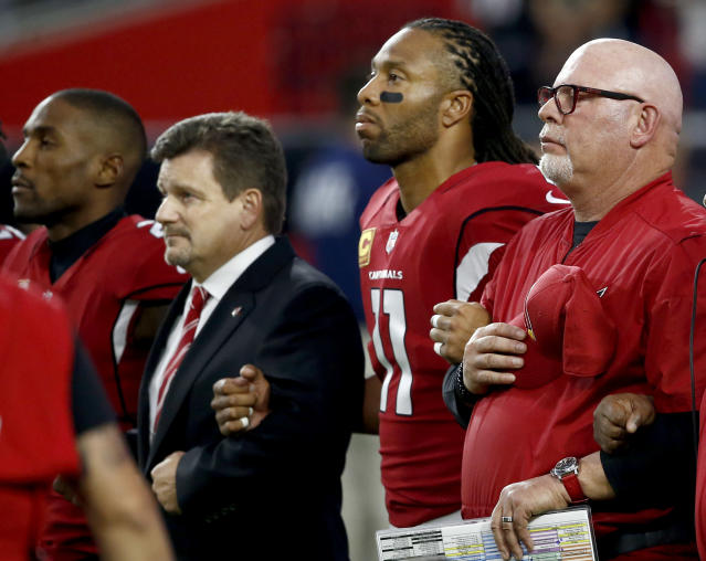 <p>From left; Arizona Cardinals cornerback Patrick Peterson, president Michael Bidwill, wide receiver Larry Fitzgerald and head coach Bruce Arians stand during the national anthem prior to an NFL football game against the Dallas Cowboys, Monday, Sept. 25, 2017, in Glendale, Ariz. (AP Photo/Ross D. Franklin) </p>