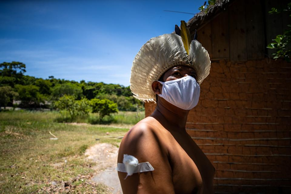 MARICA, BRAZIL - JANUARY 20: A Guarani indigenous man poses for a photo after he received a CoronaVac vaccination shot during a Covid-19 vaccination campaign at the Aldeia Mata Verde Bonita (Tekoa Ka'Aguy Ovy Porã) on January 20, 2021 in Marica, Brazil. The state of Rio de Janeiro will immunize with the first vaccine shipment Health workers, institutionalized people aged 60 or over, Indigenous and quilombolas on their own land and institutionalized people with disabilities. The CoronaVac vaccine was developed by the Chinese laboratory Sinovac in partnership with the Butantan Institute. (Photo by Buda Mendes/Getty Images)