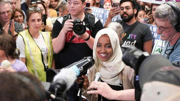 PHOTO: Rep. Ilhan Omar speaks to supporters as she arrives at Minneapolis' Saint Paul International Airport, July 18, 2019, in Minnesota. (Glen Stubbe/AP)