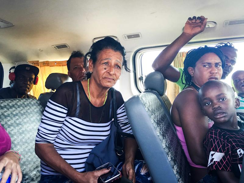 May 24, 2016 - Marta in a van with other migrants from Haiti after being detained by Peruvian migration officials. They were released after the head officer took a liking to Liset and decided to let her go. (Photo: Lisette Poole)