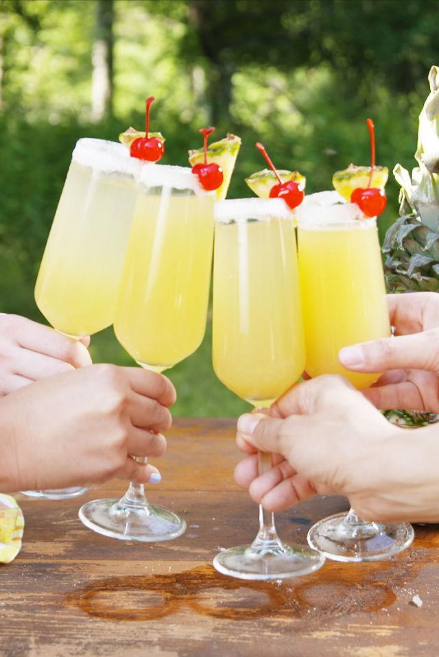 """<p>This is the perfect drink to sip beachside (or poolside) this summer.</p><p>Get the recipe from <a rel=""""nofollow"""" href=""""http://www.delish.com/cooking/recipe-ideas/recipes/a54648/pina-colada-mimosas-recipe/"""">Delish</a>.</p>"""