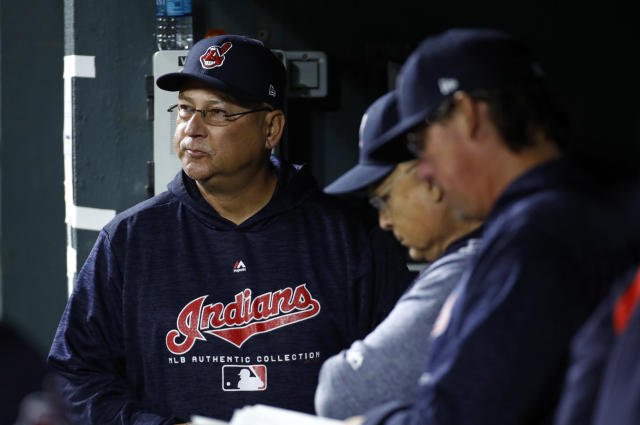 Cleveland Indians manager Terry Francona, left, stands in the dugout in the eighth inning of a baseball game against the Baltimore Orioles, Monday, April 23, 2018, in Baltimore. (AP Photo/Patrick Semansky)