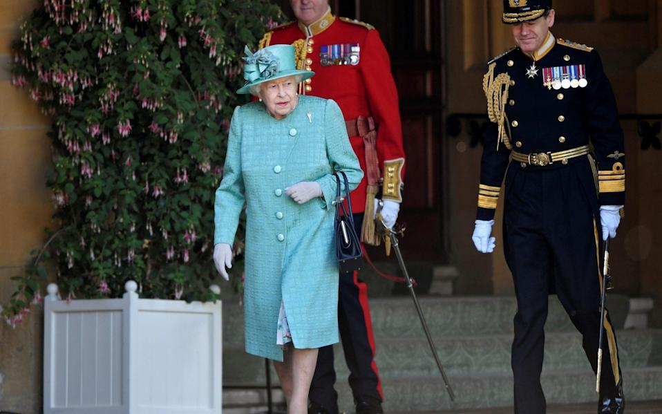 The Queen attended a ceremony to mark her official 94th birthday at Windsor Castle in Windsor on June 13 last year - Toby Melville/Reuters