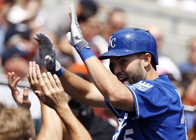 Kansas City Royals' Eric Hosmer is congratulated in the dugout after hitting a solo home run in the fourth inning during the first game of a doubleheader baseball game Friday, Aug. 16, 2013, in Detroit. (AP Photo/Duane Burleson)