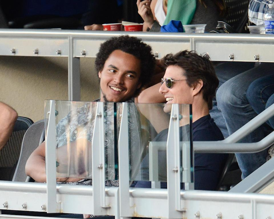 Connor Cruise and his dad, Tom Cruise, catching a Dodgers game in L.A. in October 2013. (Photo: Noel Vasquez/Getty Images)
