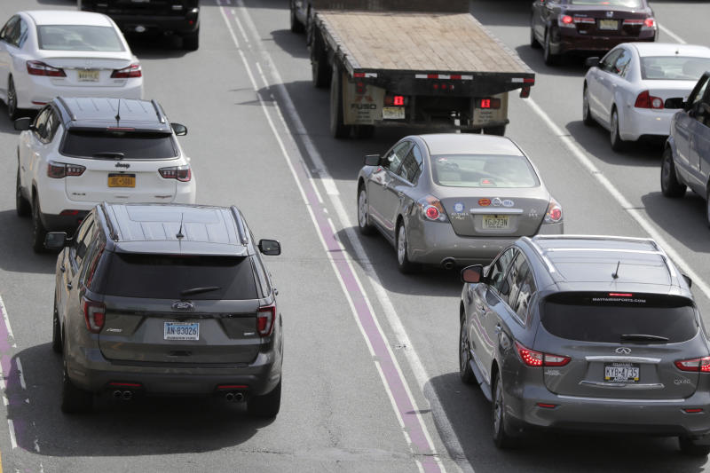 Vehicles bearing license plates from New York, New Jersey, Connecticut and Pennsylvania line up before at the George Washington Bridge toll plaza, Wednesday, April 17, 2019, in Fort Lee, N.J. U.S. Rep. Josh Gottheimer (NJ-5) and Rep. Bill Pascrell (NJ-9) held a news conference to announce they plan to fight back against New York City's proposed congestion tax on New Jersey commuters. The congressmen will propose legislation they say will ensure New Jersey motorists, who already pay up to $15 for bridge or tunnel tolls, won't be charged twice. New York's legislature approved a conceptual plan this month. that will allocate revenue to fix the city's mass transit system. New York would become the first American city to use so-called congestion pricing to reduce gridlock and fund mass transit improvements. (AP Photo/Julio Cortez)