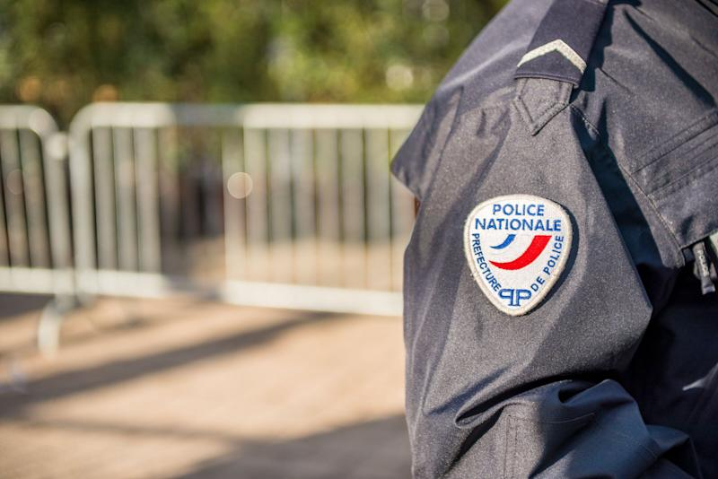 Paris, France - October 28, 2012: Close-up on a French policeman ensuring the safety of the citizens in the street, close view on his badge