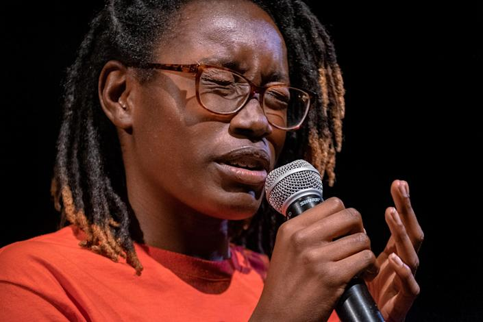 Rachel Jackson, part of the Saint Louis Story Stitchers artistic collective, delivers an original poem about the impact of gun violence at the Grandel Theatre in St. Louis on Aug. 13.