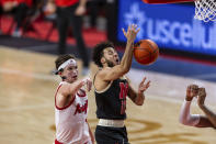 Rutgers guard Paul Mulcahy (4) blocks a layup by Nebraska guard Kobe Webster (10) in the first half during an NCAA college basketball game Monday, March 1, 2021, in Lincoln, Neb. (AP Photo/John Peterson)