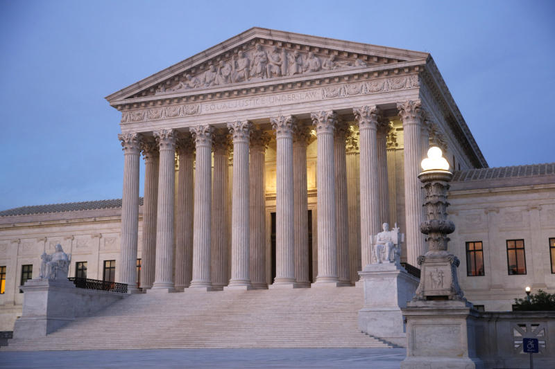 "FILE - In this May 23, 2019 file photo, the U.S. Supreme Court building at dusk on Capitol Hill in Washington. Oregon's attorney general is telling the U.S. Supreme Court that Oregon's criminal justice system would be ""overwhelmed"" if the nation's highest court rules that nonunanimous jury verdicts are unconstitutional. If the U.S. Supreme Court finds nonunanimous juries unconstitutional, Attorney General Ellen Rosenblum said in a brief filed Friday, Aug. 23, 2019, it could invalidate hundreds of convictions in Oregon. (AP Photo/Patrick Semansky, File)"