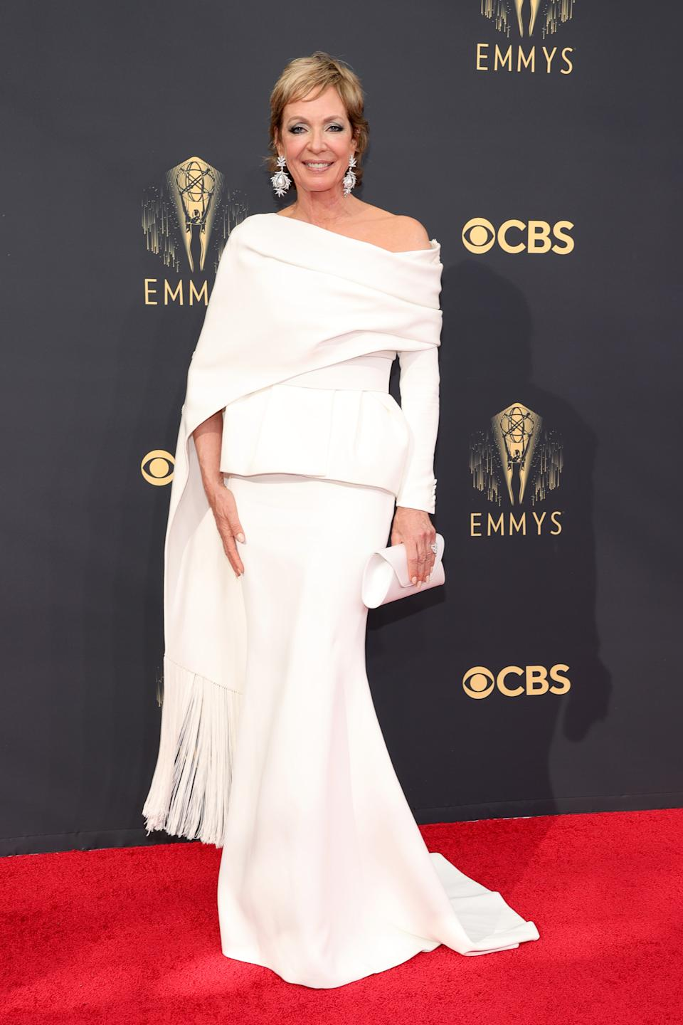 Allison Janney wears a white gown with a fringed cape at the 73rd Primetime Emmy Awards at L.A. LIVE on September 19, 2021 in Los Angeles, California. (Photo by Rich Fury/Getty Images)