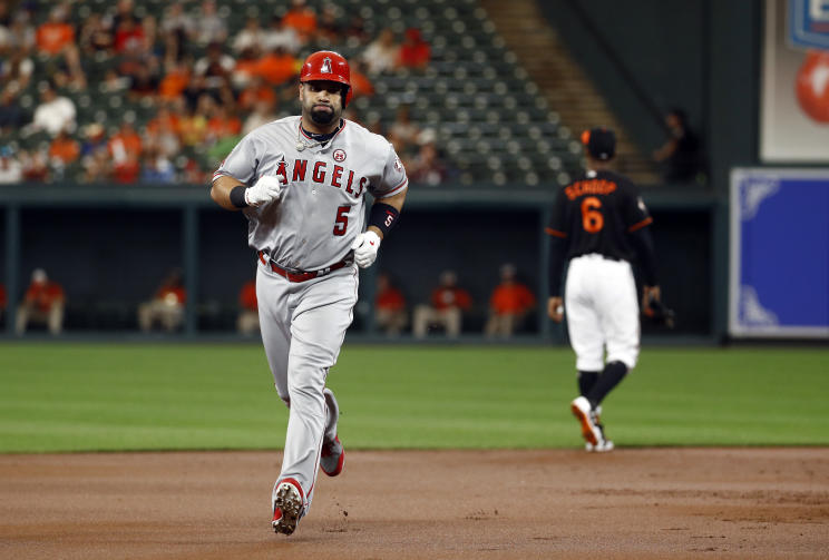 Angels slugger Albert Pujols rounds the bases after hitting a two-run home run that tied him with Sammy Sosa for the most home runs by a foreign player. (AP)