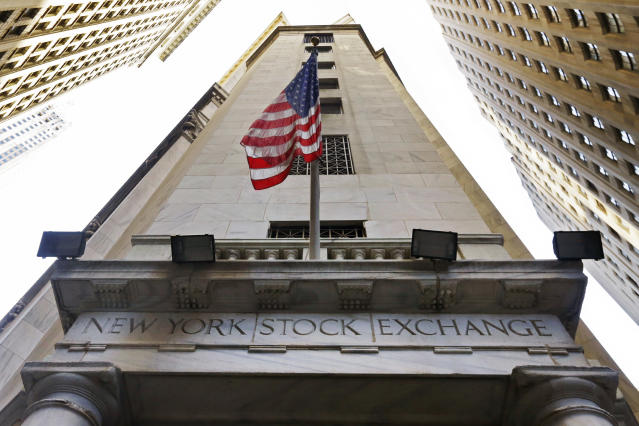 The American flag flies above the Wall Street entrance to the New York Stock Exchange. (AP Photo/Richard Drew, File)