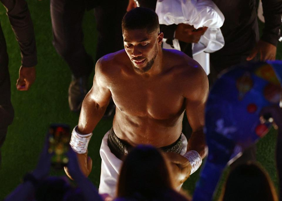 Anthony Joshua leaves the arena after losing to Oleksandr Usyk during their heavyweight boxing match at Tottenham Hotspur Stadium.