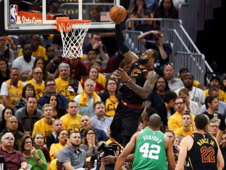 May 19, 2018; Cleveland, OH, USA; Cleveland Cavaliers forward LeBron James (23) attempts a layup in front of forward Larry Nance Jr. (22) and Boston Celtics forward Al Horford (42) during the first half of game three of the Eastern conference finals in the 2018 NBA Playoffs at Quicken Loans Arena. Mandatory Credit: Aaron Doster-USA TODAY Sports