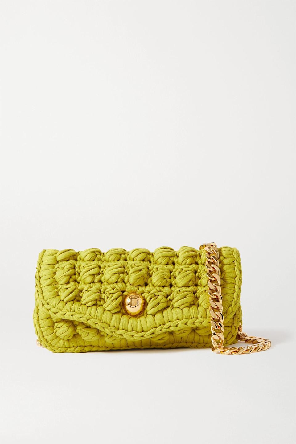 """<p><strong>Bottega Veneta</strong></p><p>net-a-porter.com</p><p><strong>$4500.00</strong></p><p><a href=""""https://click.linksynergy.com/deeplink?id=6Km1lFswsiY&mid=24449&murl=https%3A%2F%2Fwww.net-a-porter.com%2Fen-us%2Fshop%2Fproduct%2Fbottega-veneta%2Fcrocheted-cotton-blend-shoulder-bag%2F1285973"""" rel=""""nofollow noopener"""" target=""""_blank"""" data-ylk=""""slk:Shop Now"""" class=""""link rapid-noclick-resp"""">Shop Now</a></p><p>Hand-crocheted from chunky cotton-blend yarn, this bag is a true masterpiece. It will surely take you many places in 2021.</p>"""