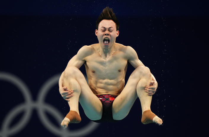 Xie Siyi of China competes in men's diving 3m springboard preliminary at the Tokyo Aquatics Centre at the 2020 Summer Olympics, Monday, Aug. 2, 2021, in Tokyo, Japan. (AP Photo/Dmitri Lovetsky)