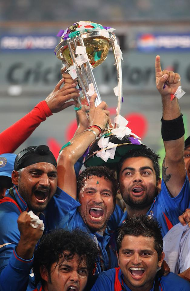 MUMBAI, INDIA - APRIL 02:  Sachin Tendulkar and Virat Kohli of India celebrate with the World Cup after beating Sri Lanka during the 2011 ICC World Cup Final between India and Sri Lanka at the Wankhede Stadium on April 2, 2011 in Mumbai, India.  (Photo by Tom Shaw/Getty Images)