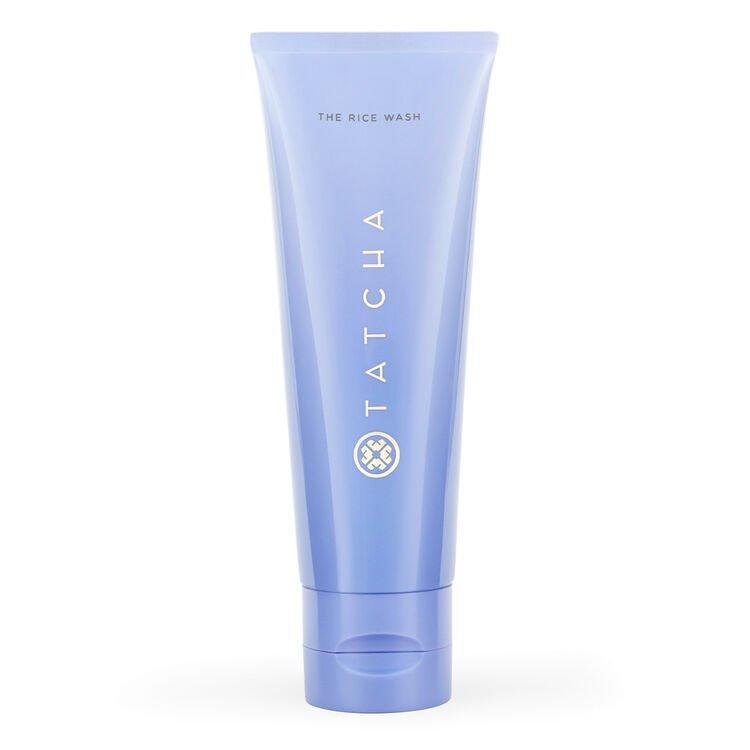 """<h3>Tatcha The Rice Wash</h3> <br>""""I'm a sucker for <a href=""""https://www.refinery29.com/en-gb/2017/05/151880/best-cleanser-your-skin-type"""" rel=""""nofollow noopener"""" target=""""_blank"""" data-ylk=""""slk:a gentle cleanser"""" class=""""link rapid-noclick-resp"""">a gentle cleanser</a> that actually cleans your face, and this new formula from Tatcha has become an instant favorite of mine. The latest from the brand has the polishing properties of its Japanese rice powder, which leaves your skin fresh and glowing once you get out of the shower. There's also hyaluronic acid and Okinawa algae in the sleek purple tube, which makes my skin feel noticeably more hydrated and plump after every use. It's the closest thing to a facial my skin has gotten since staying at home, and for that, it's the real MVP."""" — Aimee Simeon, senior beauty writer<br><br><strong>Tatcha</strong> THE RICE WASH, $, available at <a href=""""https://go.skimresources.com/?id=30283X879131&url=https%3A%2F%2Fwww.tatcha.com%2Fproduct%2FCC03010T.html"""" rel=""""nofollow noopener"""" target=""""_blank"""" data-ylk=""""slk:Tatcha"""" class=""""link rapid-noclick-resp"""">Tatcha</a><br>"""