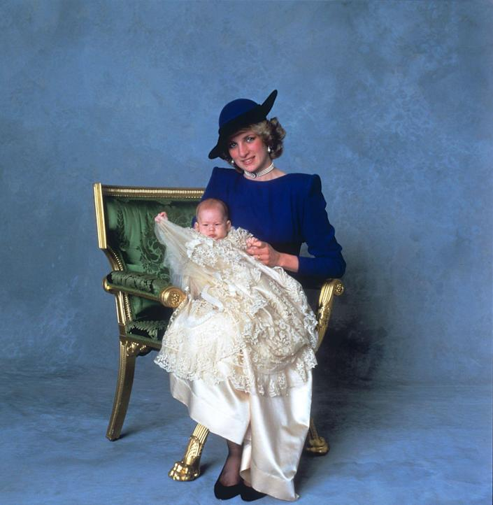 <p>Three months after his birth, Prince Henry of Wales is christened at St George's Chapel in Windsor. Here he is with his mother, Princess Diana, in an official portrait. St George's is also where Harry married Meghan Markle on May 19, 2018.</p>