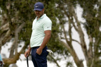 Brooks Koepka reacts after missing his putt on the sixth green during the third round of the U.S. Open Golf Championship, Saturday, June 19, 2021, at Torrey Pines Golf Course in San Diego. (AP Photo/Gregory Bull)