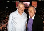 Publisher Hugh Hefner and Lakers owner Jerry Buss pose above the crowd at the Lakers v Nuggets NBA game to celebrate Hefner's 77th birthday April 10, 2003 at the Staples Center, Los Angeles, California. (Photo by David Klein/Getty Images)
