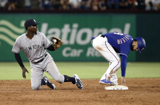 Texas Rangers Isiah Kiner-Falefa (9) stands safely on second base after a steal, as New York Yankees shortstop Didi Gregorius shows the ball to the umpire during the eighth inning of a baseball game Wednesday, May 23, 2018, in Arlington, Texas. (AP Photo/Michael Ainsworth)