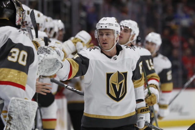 Vegas Golden Knights center Jonathan Marchessault greets teammates after scoring during the first period of an NHL hockey game against the Detroit Red Wings, Sunday, Nov. 10, 2019, in Detroit. (AP Photo/Carlos Osorio)