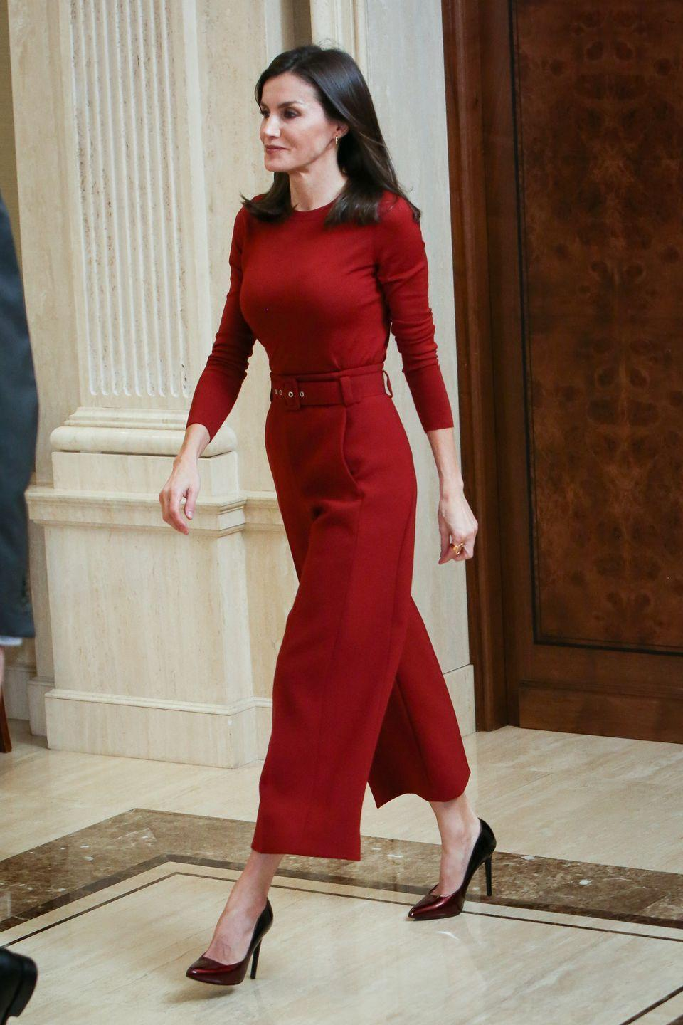 <p>Queen Letizia chose a bold red look to greet the National Water polo teams at Zarzuela Palace. </p>