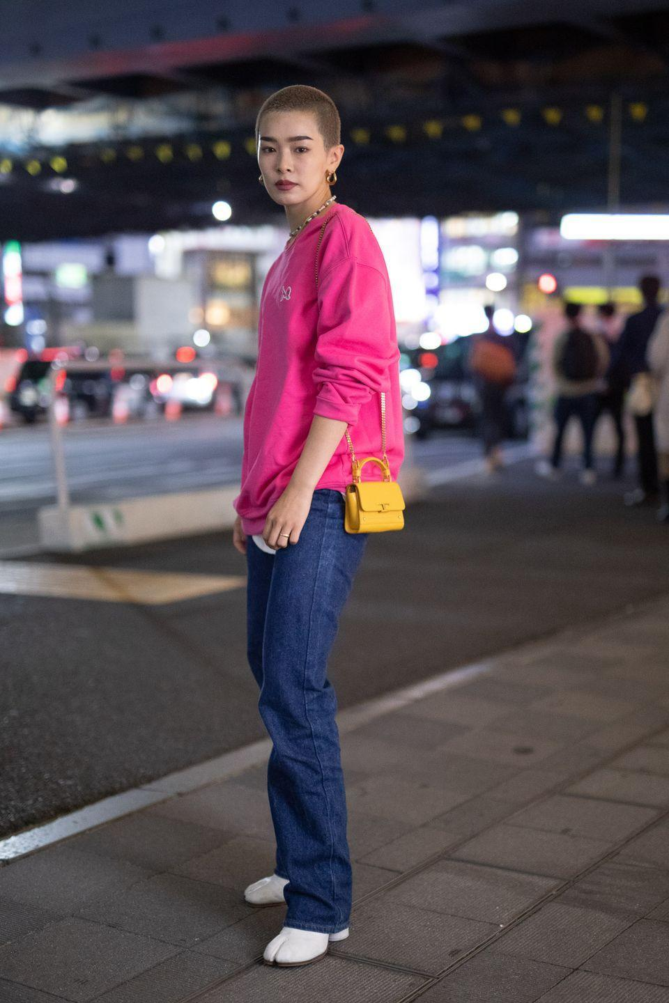 """<p>One quick and easy way to dress up Tokyo's graphic athleisure trend is to add elevated accessories. Consider taking it a step further by experimenting with pops of color. </p><p><strong>Get the look: RichardandGrace</strong> BTM crewneck, $200, <a href=""""https://www.richardandgrace.com/collections/bmt-tx/products/navy-btm-crewneck"""" rel=""""nofollow noopener"""" target=""""_blank"""" data-ylk=""""slk:richardandgrace.com"""" class=""""link rapid-noclick-resp"""">richardandgrace.com</a>.</p>"""