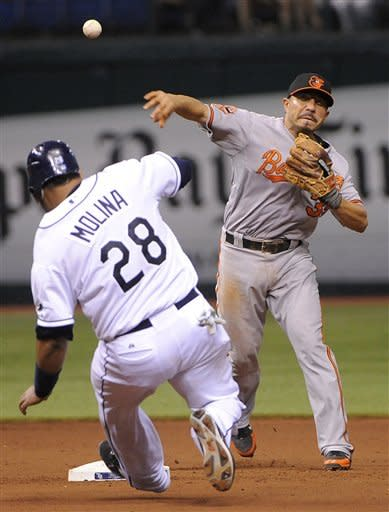 Baltimore Orioles second baseman Omar Quintanilla, right, gets the force-out at second base on Tampa Bay Rays' Jose Molina but fails to turn the double play on B.J. Upton's fielder's choice during the eighth inning of a baseball game on Saturday, Aug. 4, 2012, in St. Petersburg, Fla. (AP Photo/Brian Blanco)