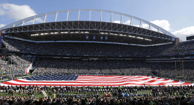 In the post 9/11 world, unfurling a giant American flag has become normal prior to football games. (AP)