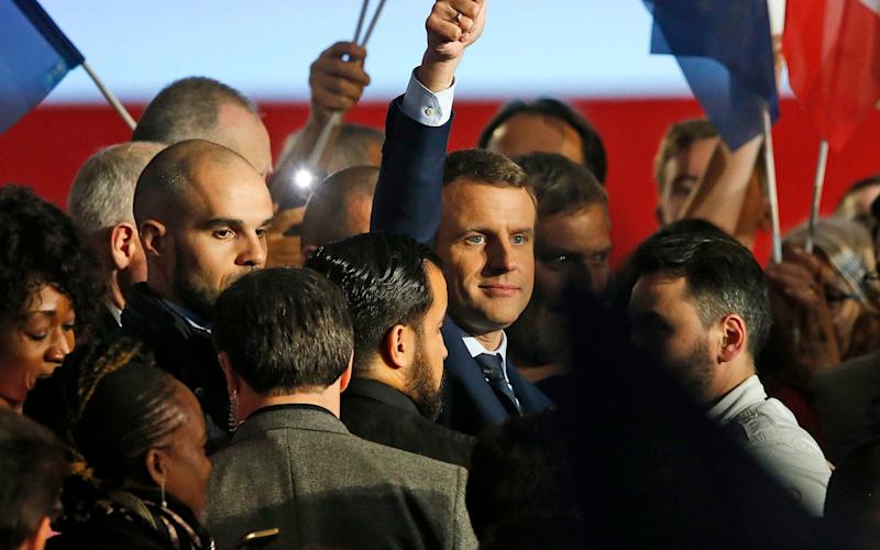Emmanuel Macron is surrounded by supporters as he celebrates at a rally in Marseille, Southern France, April 1 - EPA
