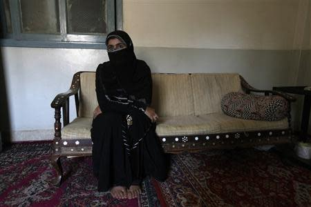 Saeeda Sarbazi, sister of Abdul Razzaq Baloch, pauses during an interview with Reuters at her residence in Karachi