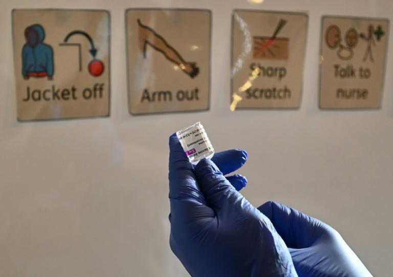 A health worker prepares a dose of the AstraZeneca/Oxford Covid-19 vaccine at a temporary vaccine centre set up at City Hall in Hull, England